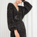 Model Front Image Of Stories In Black Silvester Outfit Kleid Silvester